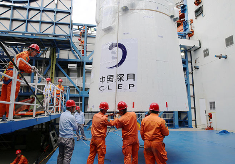 A spacecraft on the far side of the moon cannot communicate directly with the Earth. To solve this problem, China in June positioned a relay satellite called Magpie Bridge roughly 50,000 miles beyond the moon, where it will bounce transmissions between the Chang'e-4 and ground stations. Pictured: employees loading the Magpie Bridge satellite at the Xichang launch center in Xichang, on May 21, 2018