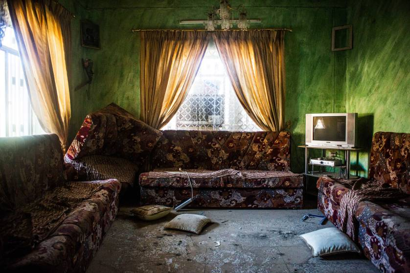 his living room was looted by ISIS militants.