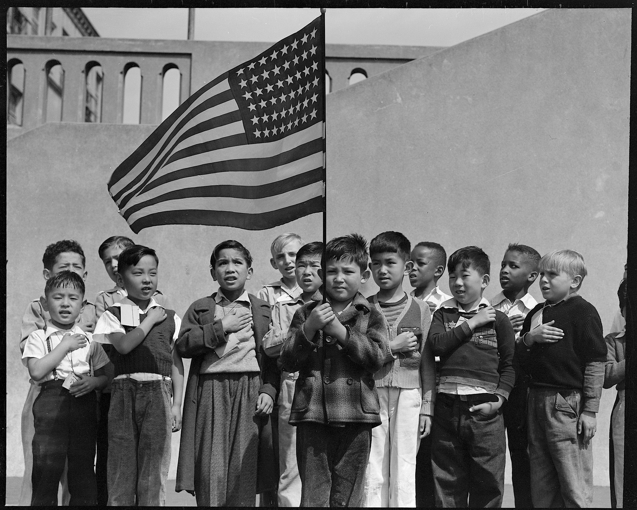 Children pledging allegiance to the American flag at San Francisco's Raphael Weill Elementary School in 1942.