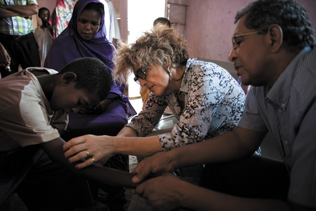 DNDi medical director Nathalie Strub Wourgaft examines a child in Sudan.